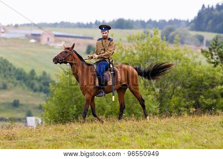 Cossack Riding On Horseback On The Field.