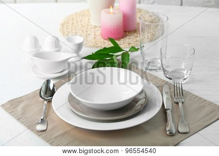 Beautiful table setting with candles close up