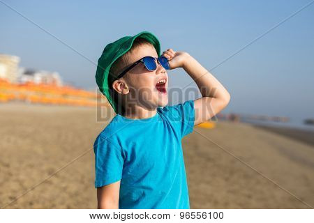 Little Boy Enjoying Summer And Shouting