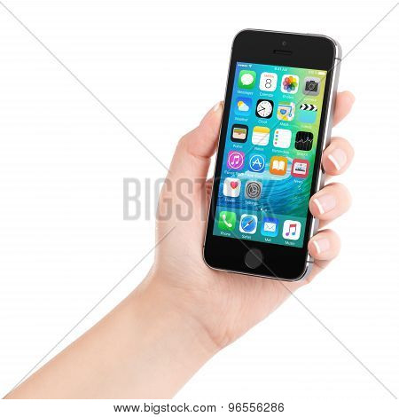 Apple Space Gray Iphone 5S Displaying Ios 9 In Female Hand, Designed By Apple Inc.