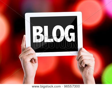 Tablet pc with text Blog with bokeh background