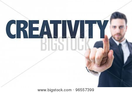 Business man pointing the text: Creativity