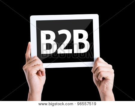Tablet pc with text B2B isolated on black background