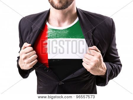 Businessman stretching suit with United Arab Emirates isolated on white