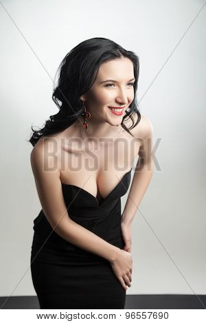 Portrait of a gorgeous smiling lady wearing black corset and skirt