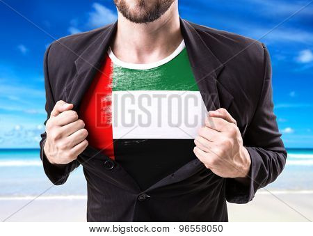 Businessman stretching suit with United Arab Emirates with beach background