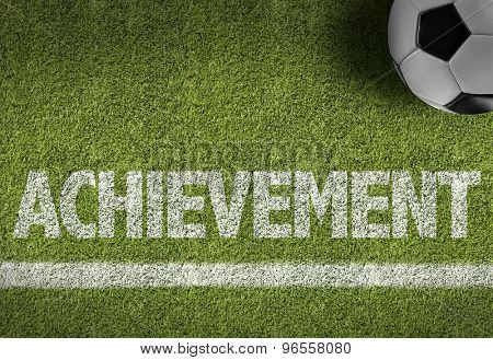 Soccer field with the text: Achievement
