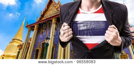 Businessman stretching suit with Thailand Flag with Temple background