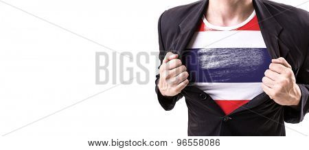 Businessman stretching suit with Thailand Flag isolated on white