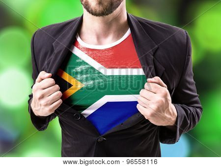 Businessman stretching suit with South African Flag with bokeh background