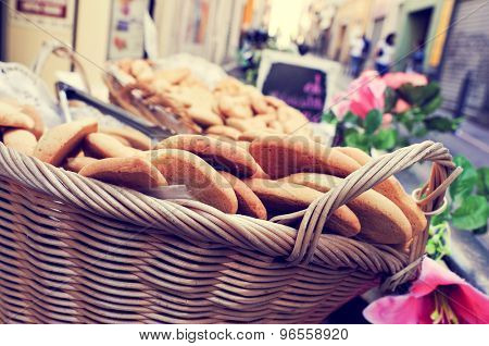 closeup of a wicker basket with cookies on sale in the old town of Marseille, France