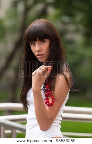 Attractive sad girl with red beads