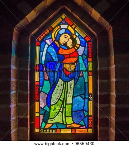 stained glass window of Mary and child