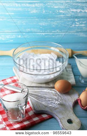 Whipped egg whites for cream on color wooden background
