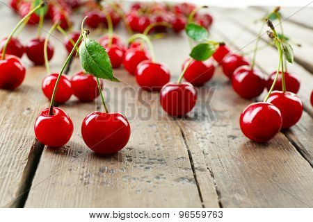 Fresh cherries on rustic wooden table, closeup