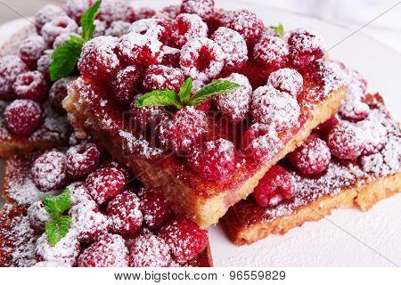 Fresh pie with raspberry and sugar, closeup