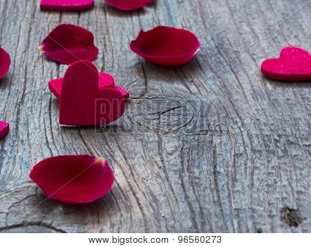 beautiful red hearts with rose petals on the wooden background, love concept