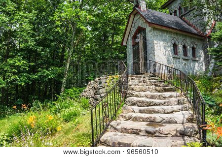 walking up the stone stairs to the entrance to the stone house