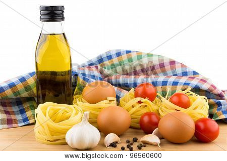 Pasta Nests, Eggs, Tomatoes, Garlic And Oil Bottle
