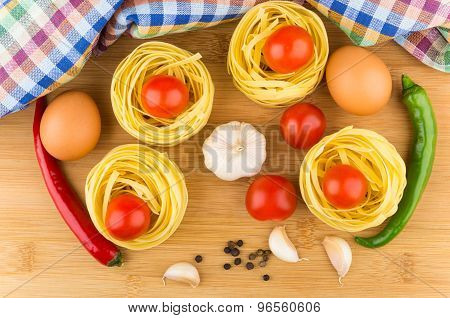 Pasta Nests, Eggs, Tomatoes, Garlic And Chili Peppers