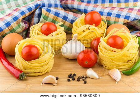 Tomatoes In Pasta Nests, Chicken Eggs, Chili Peppers And Garlic