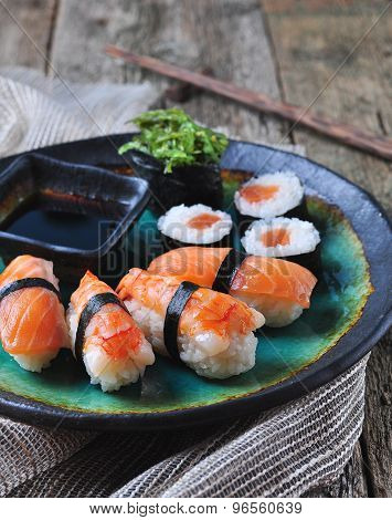 homemade sushi with wild salmon, shrimp, cucumber and seaweed. selective focus