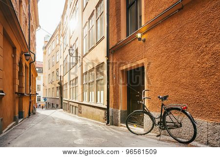 Parked Bicycle On Street Of Old European Town