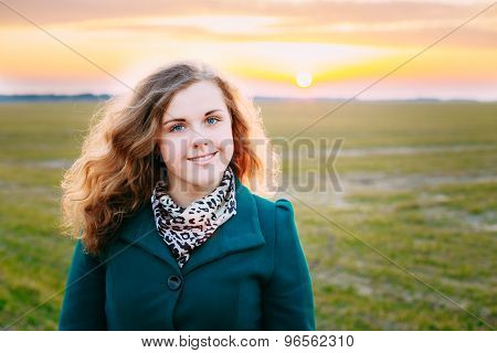 Portrait Of Beautiful Plus Size Young Woman In Blue Coat Posing