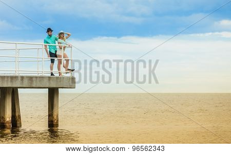 Loving Hipster Couple On Sea Pier