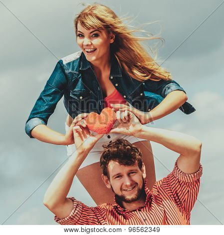 Couple In Love Holds Red Heart Outdoor