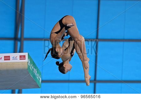 LONDON, GREAT BRITAIN - APRIL 25 2015: Jennifer Abel and Pamela Ware of Canada competing in the women's synchro 10m platform during the FINA/NVC Diving World Series at the London Aquatics Centre