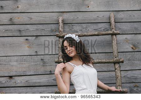 Girl climbing ladder into tree house