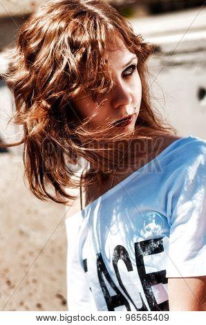 Portrait of teen girl in white t-shirt outdoor
