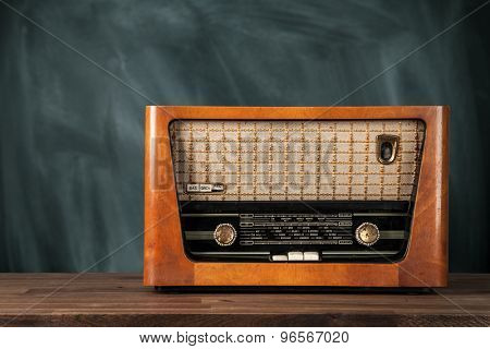 Old retro radio on wooden table