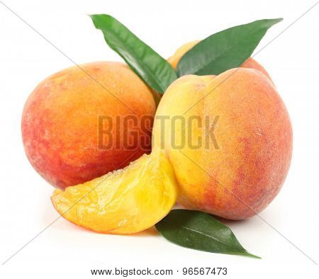 Ripe peaches isolated on white