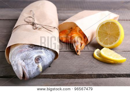 Dorado fish and other ingredients on wooden table, closeup
