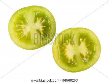 Halves of green tomato isolated on white