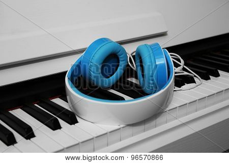 Piano with headphones close up