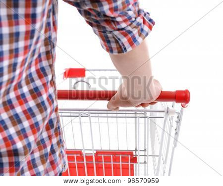 Young man with empty shopping cart isolated on white