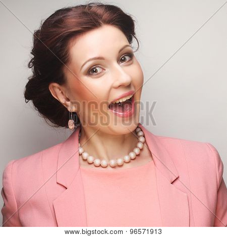 young happy businesswoman in pink