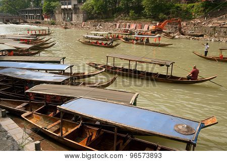 Boats waiting tourists on The River In Fenghuang Ancient City.