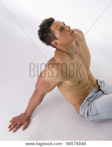 Handsome young bodybuilder laying down on the floor