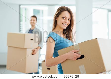 Young Couple Moving In A New House