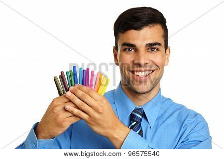 Young businessman with markers