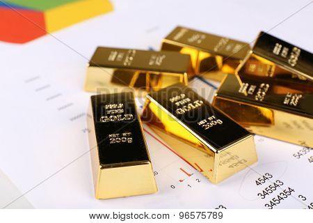 Gold bullion on documents background