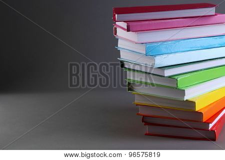 Colorful books on gray background