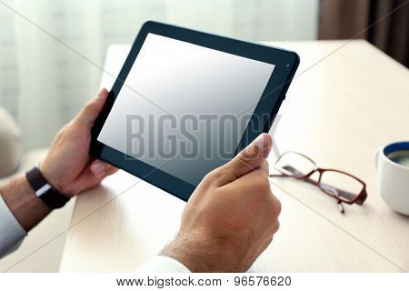 Man working with tablet in office