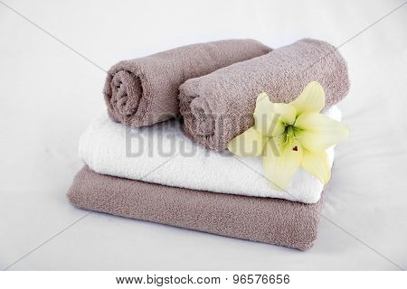 Freshly laundered fluffy towels in bedroom interior