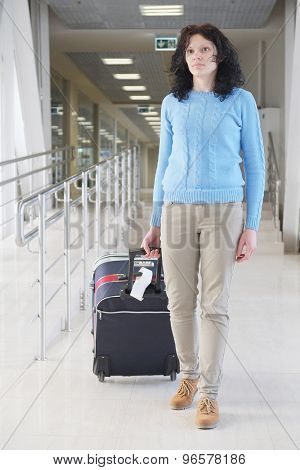 Woman carries your luggage at the airport