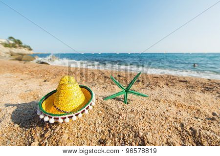 Sombrero and starfish at the Spanish beach